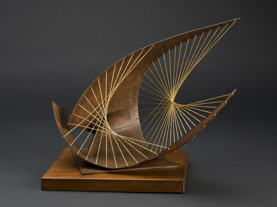 wire sculpture on wood